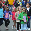 Salem:<br /> Bates Elementary School held its annual walkathon. Students collected donations based on the number of laps they walked in front of the school. Pictured walking are the 1st and kindergarten classes.<br /> Photo by Ken Yuszkus/The Salem News, Wednesday, April 24, 2013.