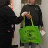 "Salem:<br /> Sharon Felton, social services coordinator at Salem Council On Aging gives William Bassett a  ""grab and go"" emergency kit. Salem's Council on Aging, Board of Health and police and fire departments are collaborating to give away ""grab and go"" emergency kits to seniors in Salem. <br /> Photo by Ken Yuszkus/The Salem News, Thursday, April 11, 2013."