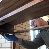 Peabody:<br /> Mark O'Hara applies stain to a secretary desk that he is refinishing at the woodworking shop which is a Peabody Council On Aging program held at the Peter A. Torigian Community Life Center.<br /> Photo by Ken Yuszkus/The Salem News, Thursday, April 4, 2013.