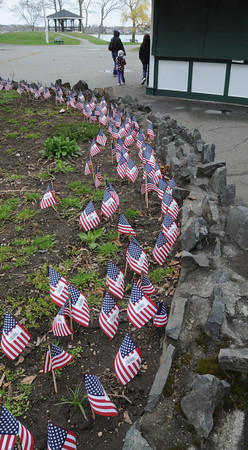 Salem:<br /> A large number of minature flags are planted in the ground in front of E.W. Hobbs, a landmark at Salem Willows. E.W. Hobbs sold hundreds of boxes of popcorn Sunday to raise funds for the family of Bill Richard, a former Salem man whose family was horribly impacted by marathon bombings.<br /> Photo by Ken Yuszkus/The Salem News, Wednesday, April 24, 2013.