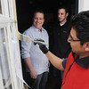 Salem:<br /> Matthew Brady, left, and partner Daniel Bitler, center, watch painter Antonio Lara paint the front door of their new restaurant, Naumkeag Ordinary.<br /> Photo by Ken Yuszkus/The Salem News, Friday, April 5, 2013.