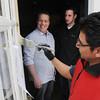 Salem:<br /> Matthew Brady, left, and partner Daniel Bitler, center, watch painter Antonio Lara paint the front door of their new restaurant, Naumkeag Ordinary.<br /> Photo by Ken Yuszkus/The Salem News, Friday, April 5, 2013.