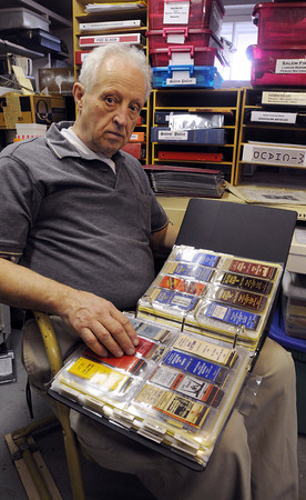 Salem:<br /> Nelson Dionne has an amazing collection of old Salem business cards, menus, stories, photos, matchbooks and more. He has just been awarded the 2013 Prize for Collecting Works on Paper from Historic New England. He is holding a book of various local matchbooks.<br /> Photo by Ken Yuszkus/The Salem News, Wednesday, April 24, 2013.