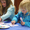 Beverly:<br /> Molly O'Shea, 4, of Beverly, left, and Anna Kalinowski, 4, of Ipswich, decorate their paper butterflies which was part of the story hour held at the Beverly Public Library on Thursday afternoon.<br /> Photo by Ken Yuszkus/The Salem News, Thursday, April 18, 2013.