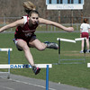 Danvers:<br /> Gloucester's Matilda Grow competes in the girls hurdles during the Gloucester at Danvers track meet. <br /> Photo by Ken Yuszkus, Monday, April 16, 2013.