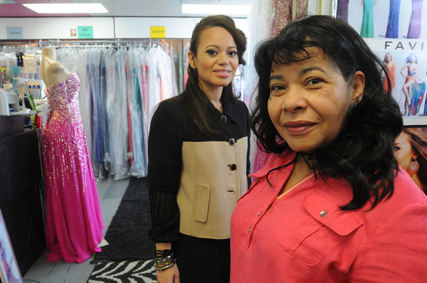 Salem:<br /> Immigrant Entrepreneur Nominee Lisandra Mones, right, and daughter Katherina Mena at their store Glitterati in Salem<br /> Photo by Ken Yuszkus, Monday, April 16, 2013.