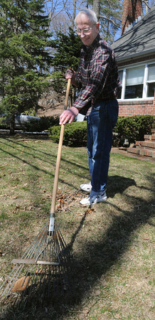 Beverly:<br /> Vick Menesale rakes his front lawn on a warm sunny Monday afternoon.<br /> Photo by Ken Yuszkus/The Salem News, Monday, April 8, 2013.
