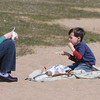 Beverly:<br /> Lisa Jones and her son Zachary of Beverly enjoy lunch in the warm sunshine at Dane Street Beach on Monday.<br /> Photo by Ken Yuszkus/The Salem News, Monday, April 1, 2013.