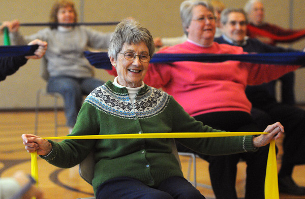 Beverly:<br /> Nancy Hall stretches an elastic ribbon while participating in the exercise for people with arthritis program at the Beverly Council On Aging on Tuesday afternoon.<br /> Photo by Ken Yuszkus/The Salem News, Tuesday, April 23, 2013.