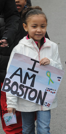 Salem:<br /> Bates Elementary School 1st grader Jocelyn Salcedo walks in the annual walkathon held at Bates Elementary School. Students collected donations based on the number of laps they walked in front of the school.<br /> Photo by Ken Yuszkus/The Salem News, Wednesday, April 24, 2013.