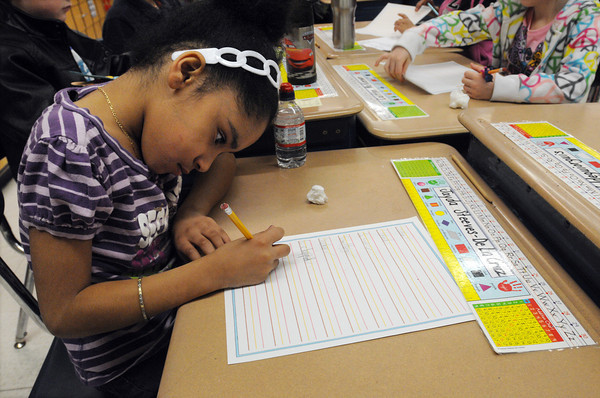 Salem:<br /> Bates Elementary School 1st grader Jayda Steeves-DeLaCruz works on her handwriting in Richard Giso's class.<br /> Photo by Ken Yuszkus/The Salem News, Friday, April 5, 2013.