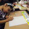 Salem:<br /> Bates Elementary School 1st grader Jayda Steeves-DeLaCruz works on her handwriting in Richard Giso's class.<br /> Photo by Ken Yuszkus/The Salem News, Friday, April 5, 2013.