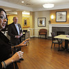 Danvers:<br /> Christine Baldini, administrator at Hawthorne Hill speaks about long term care while in the Putnam suites area at Hawthorne Hill. Peter Middlemass, vice president of sales and marketing for Genesis Health Care is in the background.<br /> Photo by Ken Yuszkus/The Salem News, Thursday, April 25, 2013.