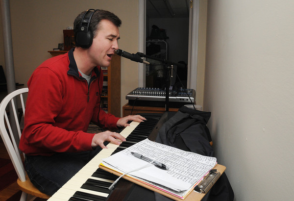 "Danvers:<br /> Matt Farley is in his recording studio in the basement of his home. He recorded 500 versions of a song called ""Will You Go To The Prom With Me?""  In each version, he sang the same song, only to a different girl's name.<br /> Photo by Ken Yuszkus/The Salem News, Wednesday, April 3, 2013."