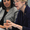 "Salem:<br /> Salem Mayor Kim Driscoll, left, listens to Senator Elizabeth Warren during the ""round table"" discussion.<br /> Photo by Ken Yuszkus/The Salem News, Friday, April 12, 2013."