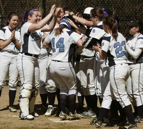 Peabody:<br /> Peabody's Holly Smith is congratulated by her teammates at home plate after hitting the game's first homerun. Peabody played Lynn Classical.<br /> Photo by Ken Yuszkus/The Salem News, Wednesday, April 17, 2013.