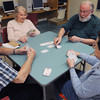 Peabody:<br /> From left, Dick Russell, Ruth Katz, Carl Ogren, and Lucy O'Brien play bridge at the Peter A. Torigian Community Life Center. Bridge is one of the scheduled activities of the Peabody Council On Aging on Thursdays.<br /> Photo by Ken Yuszkus/The Salem News, Thursday, April 4, 2013.