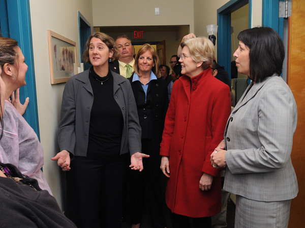 Salem:<br /> From left, North Shore Community Health, Inc. CEO Maggie Brennan, Salem Ward 1 Councilor Robert McCarthy, State Senator Joan Lovely, Senator Elizabeth Warren, and Salem Mayor Kim Driscoll, stop to talk with employees while on tour at North Shore Community Health, Inc..<br /> Photo by Ken Yuszkus/The Salem News, Friday, April 12, 2013.