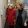 Salem:<br /> Senator Elizabeth Warren, left, looks into one of the rooms at North Shore Community Health, Inc. while on tour with Salem Mayor Kim Driscoll, center, and led by Maggie Brennan, CEO, right.<br /> Photo by Ken Yuszkus/The Salem News, Friday, April 12, 2013.
