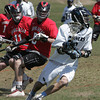 Peabody:<br /> From left, Mablehead's Crandall Maxwell and Alex Conn chase Peabody's Josh Fiore who has the ball during the Marblehead at Peabody boys lacrosse game.<br /> Photo by Ken Yuszkus/The Salem News, Thursday, April 18, 2013.