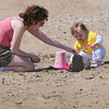 Beverly:<br /> Shannon Artis of Beverly and her 18 month old daughter Prizma play in the sand at Dane Street Beach on a warm Monday afternoon.<br /> Photo by Ken Yuszkus/The Salem News, Monday, April 8, 2013.