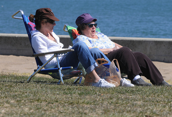 Beverly:<br /> Joanne Huggett, left, of Hamilton and Lou Femino of Beverly have their lunch in the sun at Dane Street Beach on Monday afternoon.<br /> Photo by Ken Yuszkus/The Salem News, Monday, April 8, 2013.
