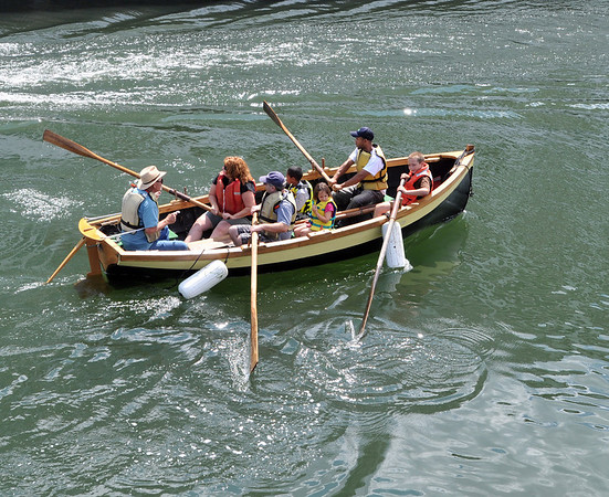 People go for a row in a historic wooden dory during Salem Heritage Days.  photo by Mark Teiwes / Salem News