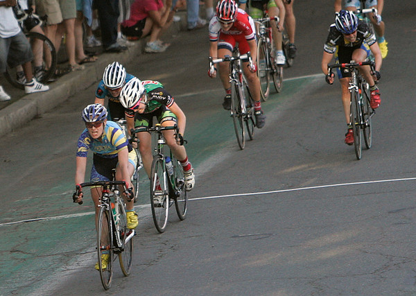 Kat Carr crosses the finish line as winner of the Witches Cup bicycle race in Salem. Carr beat out 28 other competitors in the thirty-six minute race around Salem Common. Photo by Mary Catherine Adams/Salem News.