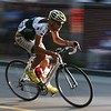 Jesse Anthony,winner of the elite men's race in  Salem's Witches Cup bicycle race, rounds the corner onto Route 1A early in the race around Salem Common. Anthony, of Beverly, Mass., beat 70 other race finishers for the win. Photo by Mary Catherine Adams/Salem News.