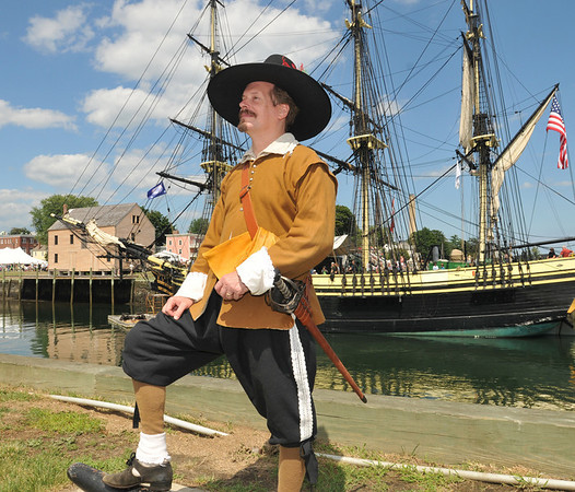Paul Kenworthy, dressed as the captain of the Salem trained band, brought out his 17th century town militia for the Maritime Festival.  photo by Mark Teiwes / Salem News