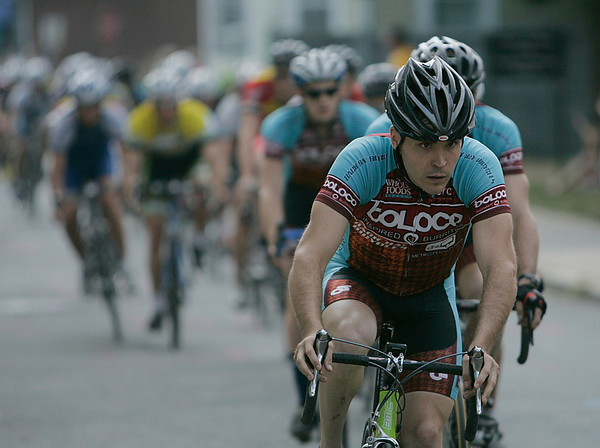 A long line of competitors in the 2010 Beverly Grand Prix, men's 4/5 race, speed along a straightaway before heading into one of the most treacherous turns, right across from Casa de Moda heading towards the Beverly Public Library. Photo by David Le/Salem News
