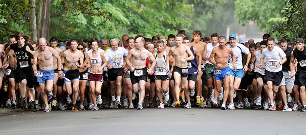 Runners take off from the starting line of the 43rd annual Beverly Homecoming Road Race.     photo by Mark Teiwes / Salem News