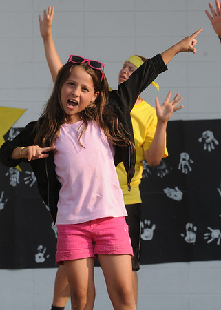 """Staci Dipalma, along with the Goldway playground group, lip sync to """"Airplanes"""" by B.O.B during the Lip Sync Extravaganza at Lynch Park in Beverly on Tuesday night. Photo by Ken Yuszkus."""