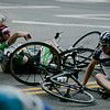 Beverly: After a brutal 15-bike crash coming around a sharp turn, a few of the racers try and untangle themselves from each other and their bikes and continue on with the race. Photo by David Le/Salem News