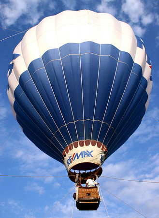 """A RE/MAX hot-air balloon soars about 100 feet above Lynch Park during the first weekend of  Beverly Homecoming. The festivities will continue all week, ending on Sun., Aug. 8, with the """"Fireworks at Dusk"""" fireworks show in Lynch Park. Photo by Mary Catherine Adams/Salem News."""