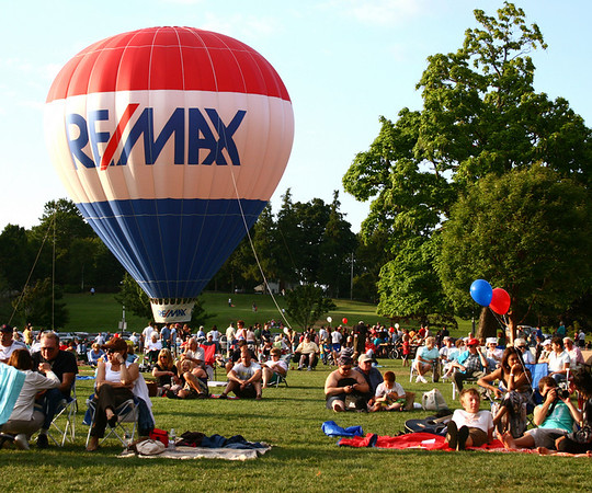 A RE/MAX hot-air balloon dominates Beverly's Lynch Park on Sunday during the first weekend of the Beverly Homecoming festivites. RE/MAX was offering balloon rides for $5 donations, the proceeds of which will be donated to the fireworks fund for Friday evening's upcoming fireworks show. Photo by Mary Catherine Adams/Salem News.