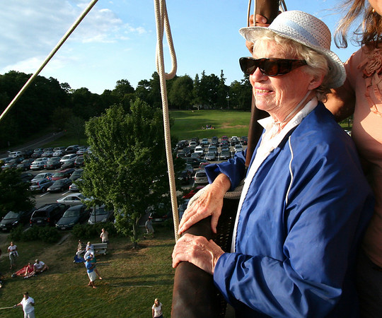 June VanKnowe, 74, takes in the view on her first ever balloon ride. Being in the balloon, she said, was not as scary as the time she rode in a helicopter. Photo by Mary Catherine Adams/Salem News.