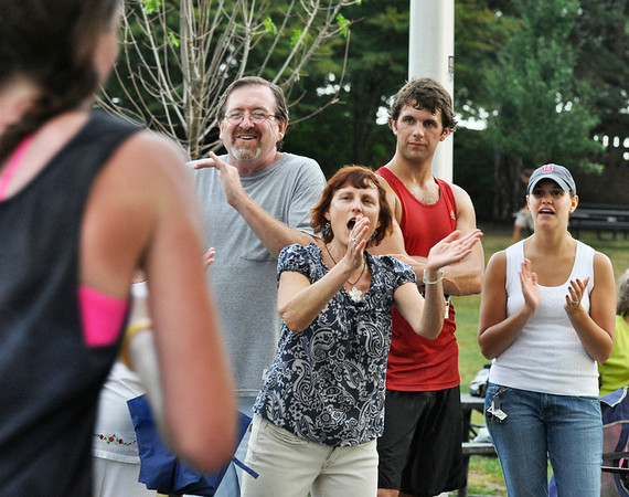 People cheer for family and friends at the end of the race.   Photo by Mark Teiwes / Salem News