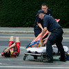 EMTs quickly responded to a fallen rider during the men's 4/5 race during the 2010 Beverly Grand Prix held on Wednesday afternoon. Photo by David Le/Salem News