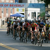 A large field of riders in the men's 4/5 race cross the finish line and look to complete another lap in their race. The Grand Prix of Beverly was held Wednesday afternoon and ran well into Wednesday evening. Photo by David Le/Salem News