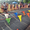 Racers push to the finish line at Lynch Park.   photo by Mark Teiwes / Salem News