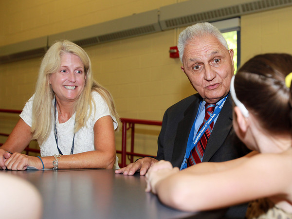 Beverly: Hannah Elementary School Principal Susan Snyder, left, and Interim Superintendent of Beverly Public Schools, Albert Argenziano, center, talk to Hannah Elementary School first grader Autumn Tucker, on the first day of school on Tuesday morning. David Le/Salem News
