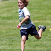 Beverly: Eight-year-old AJ Quealy, of Beverly, sprints at top speed down the hill at Lynch Park, carrying an egg he stole back to his team during a capture the egg contest during Luau Day, run by the combined Beverly and Peabody Recreation Departments at Lynch Park in Beverly. David Le/Salem News