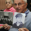 Beverly:<br /> Edward Winslow who served in the Korean War holds photos from that time in his life. He came to The Salem News to have his photos scanned. North of Boston Media Group is gathering photos of veterans of war for a collector's edition coffee-table book to be be out in December. For information on how to purchase a book, see our ad PAGE ##, or visit WEBSITE.<br /> Photo by Ken Yuszkus, Salem News, Monday, August 12, 2013.