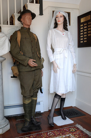 """Peabody:<br /> A World War I U.S.Army uniform and a nurse outfit are on display at the """"Downton Abbey Style,"""" exhibit showing clothing from the Downtown Abbey era -- World War I to the Jazz Age at the Peabody Historical Society.<br /> Photo by Ken Yuszkus, The Salem News, Friday, August 16, 2013."""