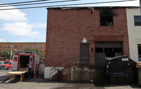Beverly: Work to board up a machine shop located at 93 Park St. in Beverly was ongoing early Friday afternoon after a fire broke out in the shop early Friday morning. David Le/Salem News