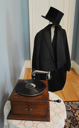 "Peabody:<br /> A working 1900 Victrola with a men's suit with tails made in Peabody in 1900 and a top hat are on display at the ""Downton Abbey Style,"" exhibit showing clothing from the Downtown Abbey era -- World War I to the Jazz Age at the Peabody Historical Society.<br /> Photo by Ken Yuszkus, The Salem News, Friday, August 16, 2013."