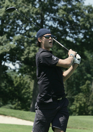 """Middleton:<br /> Boston Bruins player Tuukka Rask follows his ball off the 1st tee at the Ferncroft Country Club during the fourth annual """"Putts and Punches for Parkinson's"""" Golf Tournament. <br /> Photo by Ken Yuszkus, Salem News, Monday, August 12, 2013."""