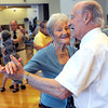 Beverly:<br /> Simone Roy and John Oliver dance during the Big Band dance at the Beverly Senior Center hosted by Council on Aging which was part of Beverly Homecoming.<br /> Photo by Ken Yuszkus, Salem News , Tuesday, August 6, 2013.