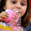 Salem:<br /> Annie Swanson, 5, creates bubble art in the childrens activity room at the Salem Public Library on Thursday afternoon.<br /> Photo by Ken Yuszkus, Salem News, Thursday, August 15, 2013.